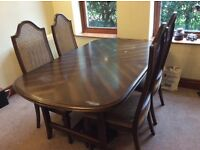 For sale: Very solid and high quality dining room table and 6 chairs.