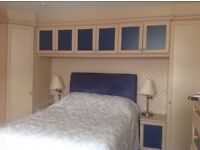 Langdale fitted wardrobes,side cupboards and over bed cupboards.
