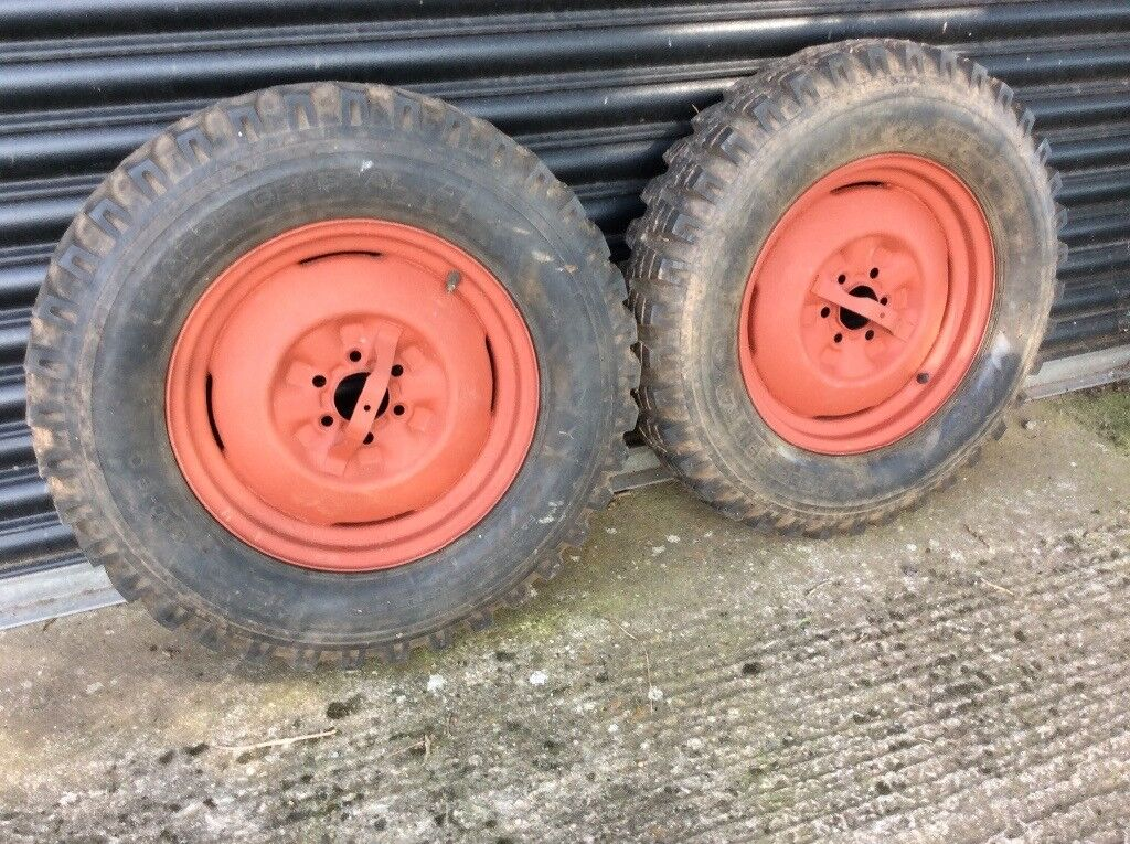 Two 600-16C NATO pattern tyres on six stud wheels