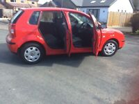 5 door 5 speed,VW, POLO E, 2004, 1198 (cc) in brilliant red with time warp interior