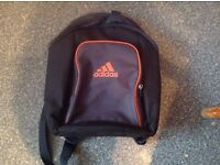 BRAND NEW small Adidas rucksac. Bought by mistake online. Would be great for hols/festivals/school..