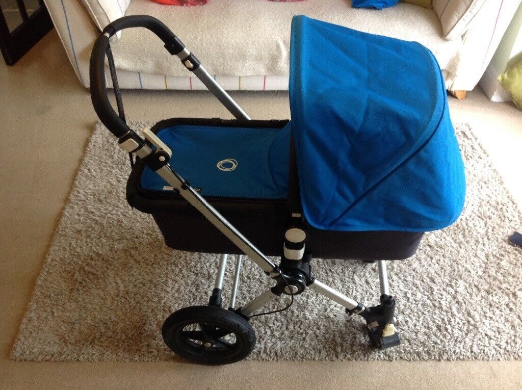Bright blue Bugaboo Camelon 2, buggy board, foot muff, parasol, cup holder, car seat adaptors, +more