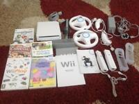 Wii console plus all leads, controllers and several games