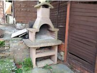 Large outdoor stone barbecue