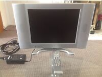 """Alba 15"""" tv with built in DVD player and remote"""