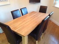 SOLID OAK DINING TABLE AND SIX BROWN FAUX LEATHER HIGH BACK CHAIRS X 6 APPROX 4 YEARS OLD BARGAIAN