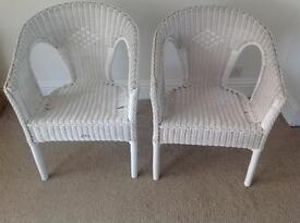 2 White wicker chairss