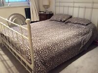 King sized white wrought iron bed. Good condition.