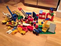 Bundle of duplo with blocks, vehicles and figures.