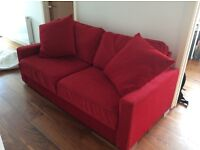 5ft Red Sofa Bed, with folding down sprung mattress, immaculate condition.