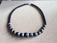 Ladies necklace. Black with jewel detail.