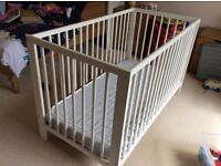 IKEA cot with mattress, white painted wood in good condition.