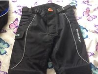 IXON MOTORBIKE TROUSERS SIZE M. EXCELLENT QUALITY AND CONDITION. USED ONLY A FEW TIMES