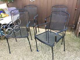 Sets of metal garden chairs