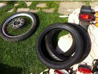 Some various sized motorbike tyres , new