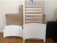 Baby cotbed from John Lewis. Becomes a bed as well once a child is older