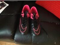 Various men's football boots