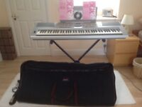 Yamaha DGX-205 portable grand keyboard. Excellent condition. Plus stand and case.