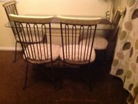 Glass dining table 4cast iron chairs