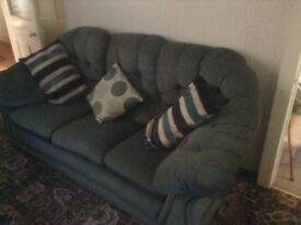 Suede effect teal 3 seater settee . Excellent condition