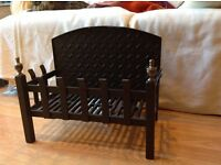 Traditional cast iron crafted fire basket with integral fireback