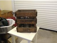 Antique schweppes crates and soda syphons