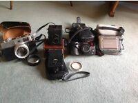 Bundle of cameras. Baby Box, Olympus Superzoom 110, Sony Handy Cam