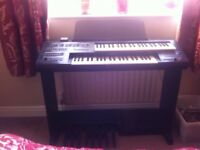 Yamaha Electone ME50 plus a selection of music books