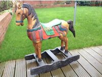 Carved colourful wood rocking horse