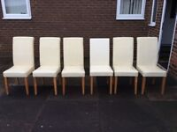 6 cream leather chairs all in good condition