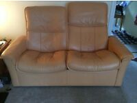 Two seater leather reclining back settee