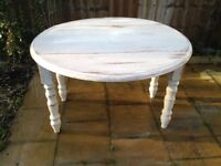 Beautiful shabby chic circular table with2 drop leaf sides