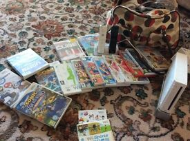 Nintendo W11 console, keep fit pad and 16 games