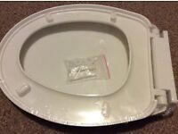 White brand new toilet seat