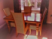 Dining table with extension and 4 cane dining chairs in pine.
