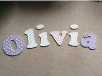 'Olivia' in wooden letters