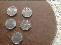 Five 50pence coins