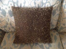 Gold beaded cushion