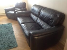 Black leather sofa and matching armchair