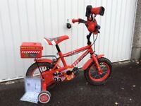 "Boy's age 3-5, 12"" red bike in excellent condition"