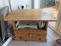 Solid pine TV stand with covered compartment at the bottom