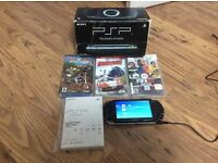 PSP PlayStation. 3 games used. Good condition.