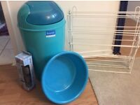 Swing bin basin clothes dryer and brush hooks