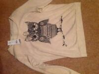 Brand new oatmeal sweatshirt with owl design on front.