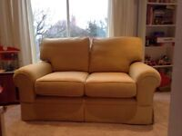 Laura Ashley two seater sofa, mustard/gold, very good condition