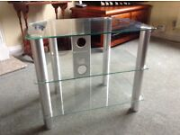 Three glass shelf tv table as new condition.