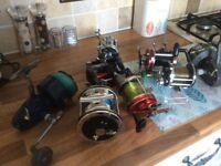 Assortment of fishing reels don't know anything about them
