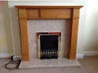 Electric fire, wooden fireplace & marble surround.