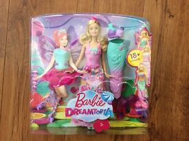 Barbie dreamtopia 3 plus barbie doll and 3 dress up outfits.