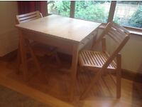 IKEA Pine table and two folding Chairs